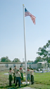 Boy Scouts raise the flag at the dedication ceremony